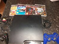 PS3 Slim 500 GB with 4 games and 2 controllers