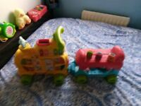 V tech interactive train and trailer with bricks