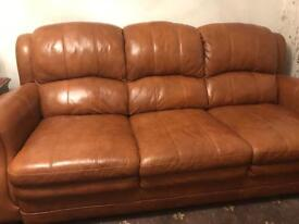 Sofa and two chairs.
