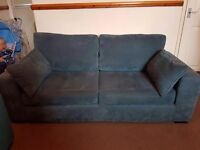 Large teal sofa less than a year old