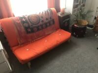 Funky/ comfy orange sofa bed/ futon