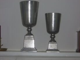 "Pair of large silver coloured urns. Ideal interior design items. 20"" tall and 15"" tall"