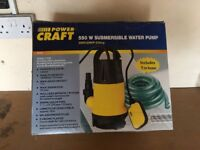 Submersible water pump brand new with 7 metres of hose