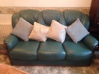 Green leather sofa and two matching chairs - cushion covers included also.