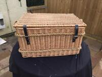 Large wicker basket with hinged lid.
