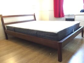 Nice and solid dark wood double bed frame from ikea Stockholm collection