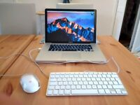 MacBook Pro 15 inch I7 2.2ghz 16gb ram ssd drive apple mouse and keyboard