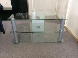 Glass tv table silver legs can hold 50 inch tv.