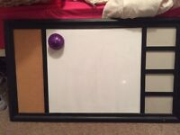 Large whiteboard with cork board and photos