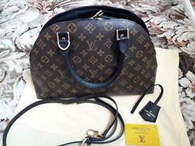 Louis Vuitton leather bag , used few times ( looks like brand new )