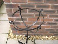 A black metal garden planter.