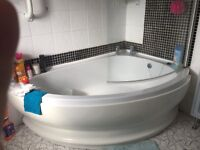 Offset corner bath and shower
