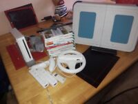 Nintendo Wii with games and steering wheel and step board