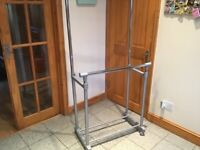 Double clothing rail-height adjustable to over 5 feet -lightweight,has wheels-£20