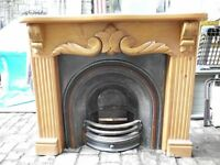 INSET CAST IRON FIREPLACE WITH WOOD SURROUND