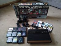Atari video games console (model 2600) and games. Buyer collects