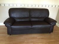 Three seater, faux leather sofa.