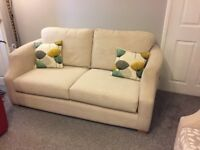 Cream material sofa and chair
