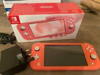 Nintendo Switch Lite coral, with Crash Bandicoot, sale or trade
