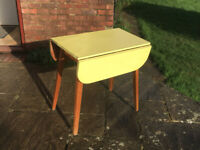 Yellow Drop Leaf Melamine Kitchen Table Antique 1950-style Great condition.