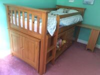'Next' children's cabin bed with drawers, shelves, desk and small cupboard with rail.