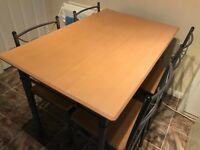 Table and chairs . Small and practical