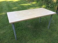 Birch coloured Ikea desk / dining table with silver height adjustable legs
