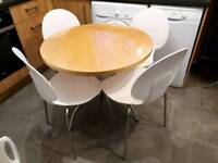 Modern round beechwood dining table with four chairs. Delivery available