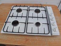 AEG white Gas hob with 4 black pan plates