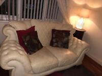 Cream Italian leather 3 + 2 seater sofa with coffee table.