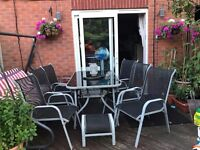 Glass Garden Table with 6 chairs and footstool Set