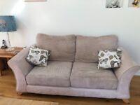 2 seater cream fabric sofa and matching cuddler sofa