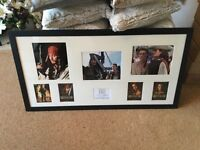 Signed Pirates of the Caribbean photo frammed