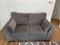 2 seater sofa in Pewter Grey by Wrought Studios. Mostly unused. No stains/marks