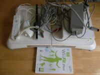 Wii Fit Plus and Nintendo wii set up with balance board