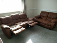 2 and 3 seater reclining sofa in brown faux leather only 2 years old