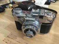 Vintage camera with original leather bag.