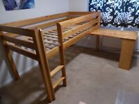 Raised single bed with pull out desk