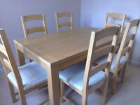 Dining room table and chairs oak finish chairs have lovely material covering.