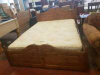 Large pine kingsize bed frame with mattress and four drawers