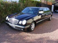 limousine for sale.mercedes e240 six door ,black with blue inter.