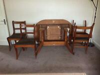 Vintage mahogany oval top extendable dining table with Claw feet.