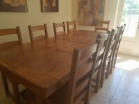 Beautiful old oak heavy dining table with 10 chairs