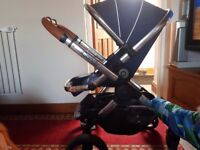 Comes with carry cot' liner' height adapters' rain cover and all manual