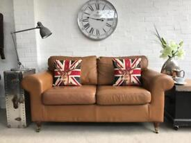 Tan leather 2 seater sofa. Can deliver..