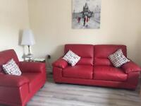 Like New. Red leather sofa and chair set