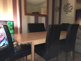 Designer dining table and 6 leather memory foam chairs