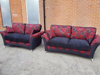 Fabulous sofa suite. 3 and 2 seater black and red sofas.BRAND NEW in the boxes. Can deliver