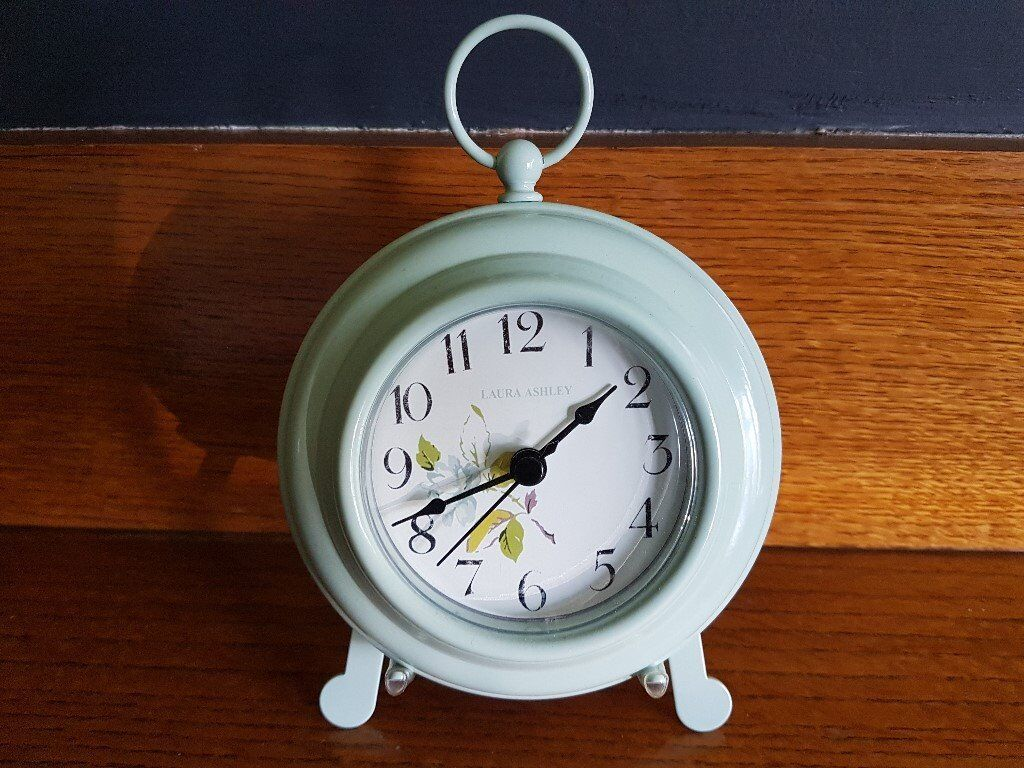 Laura Ashley mantle/kitchen clock with stand. Light green with stand. Very good condition.