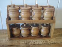 Set of 8 wooden storage jars/spice pots and stand.Country style kitchen. Lovely condition.